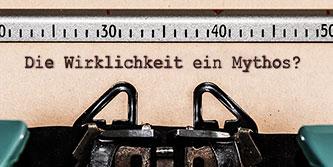 Bild von einem eingespannten Blatt in einer Schreibmaschine. Text: Ist die Wirklichkeit ein Mythos?